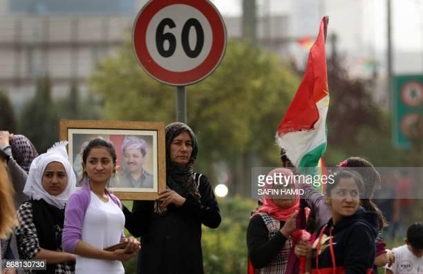 Iraqi Kurds march during a protest in support of the Iraqi Kurdish leader in Arbil the capital of autonomous Iraqi Kurdistan on October 30 2017...