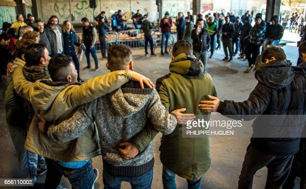 Iraqi Kurds migrants dance as musicians play in La Liniere camp in GrandeSynthe northern France on March 21 during the celebrations of Nauroz 'New...