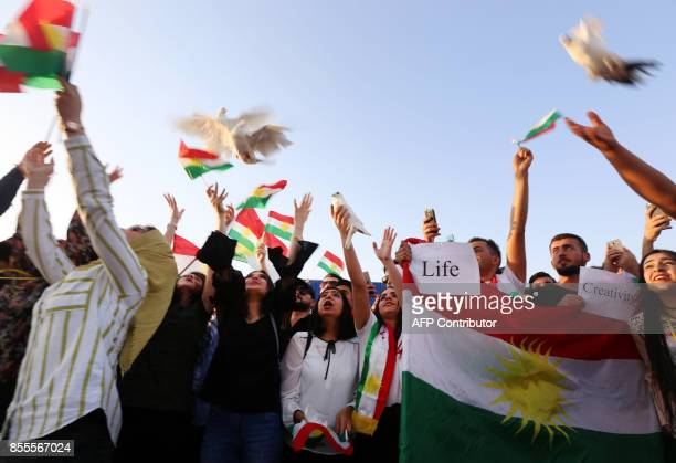 Iraqi Kurds release doves during in a demonstration at Arbil airport in the capital of Iraq's autonomous northern Kurdish region after the central...
