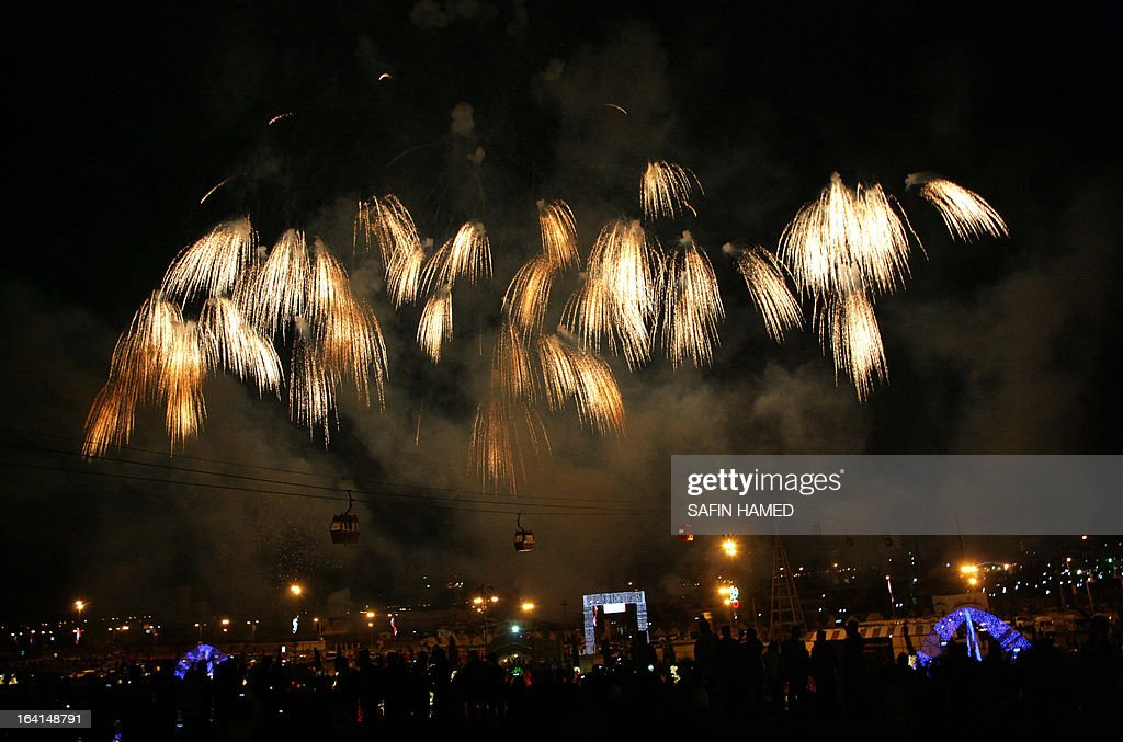 Iraqi Kurds watch fireworks as they celebrate new year which marks the beginning of the Noruz spring festival in the northern city of Arbil, the capital of the autonomous Kurdistan region, on March 20, 2013. The Persian New Year is an ancient Zoroastrian tradition celebrated by Iranians and Kurds which coincides with the vernal (spring) equinox and is calculated by the solar calender.