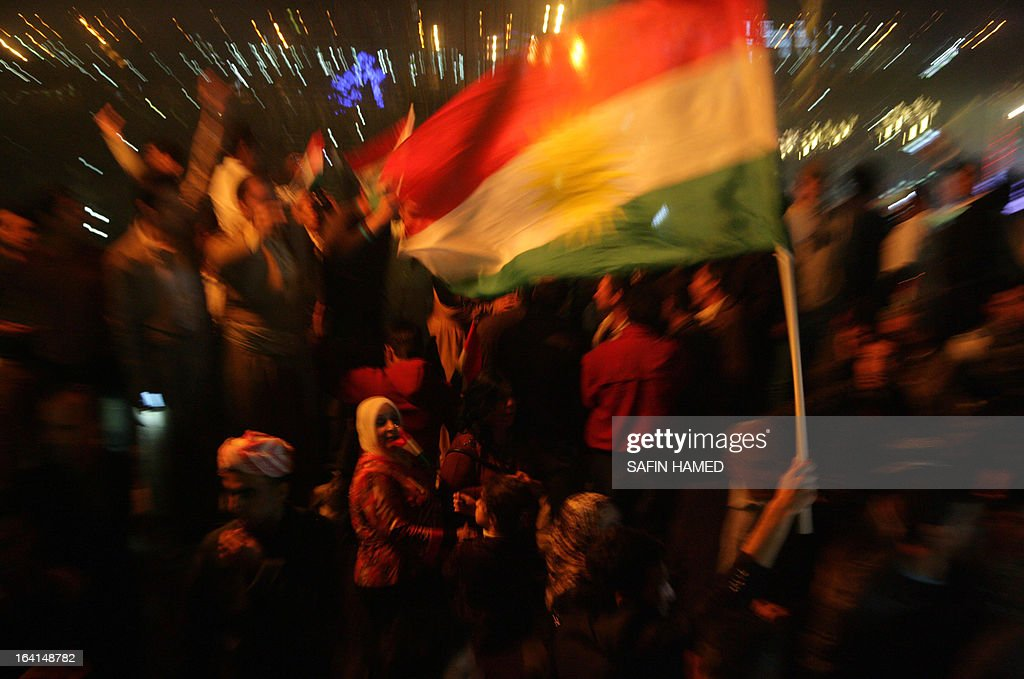 Iraqi Kurds wave the Kurdish flags to celebrate new year which marks the beginning of the Noruz spring festival in the northern city of Arbil, the capital of the autonomous Kurdistan region, on March 20, 2013. The Persian New Year is an ancient Zoroastrian tradition celebrated by Iranians and Kurds which coincides with the vernal (spring) equinox and is calculated by the solar calender. AFP PHOTO / SAFIN HAMED