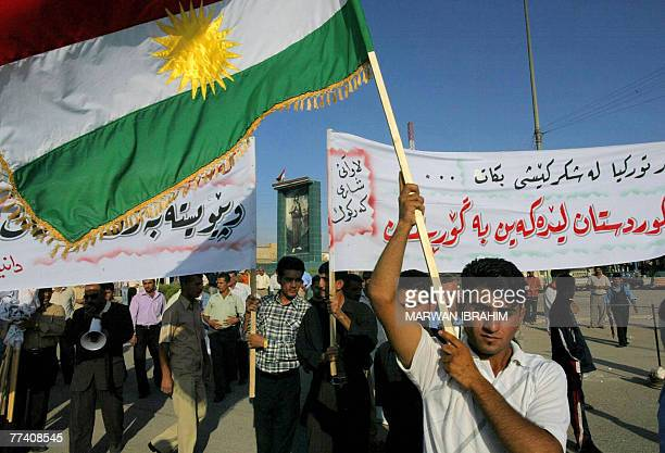 Iraqi Kurds wave their regional flag during a demonstration against the Turkish military threat in the oil rich city of Kirkuk 255 kms north of...