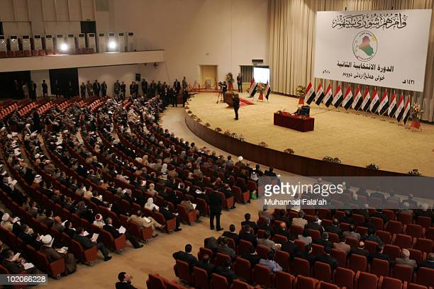 Iraqi lawmakers are seen taking the oath during the first session of the Iraqi Parliament on June 14 2010 at the Green Zone in Baghdad Iraq The Iraqi...
