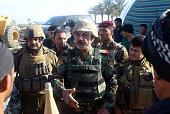Iraqi Major General Kadhem Mohammed alFahdawi the new Anbar police chief speaks to progovernment fighters in Amriyat alFallujah 30 kilometres south...