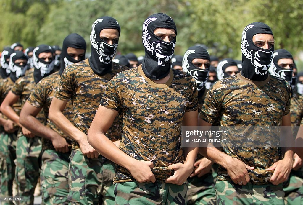 Iraqi members of the powerful Iran-backed Badr Brigades take part in a parade marking al-Quds (Jerusalem) Day in the capital Baghdad, on July 1, 2016. RUBAYE