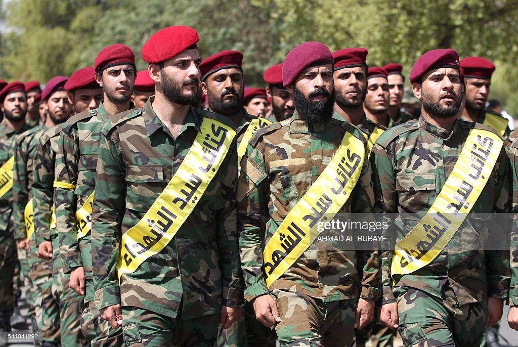 Iraqi members of the Sayed al-Shuhada Brigades take part in a parade marking al-Quds (Jerusalem) Day in the capital Baghdad, on July 1, 2016. RUBAYE