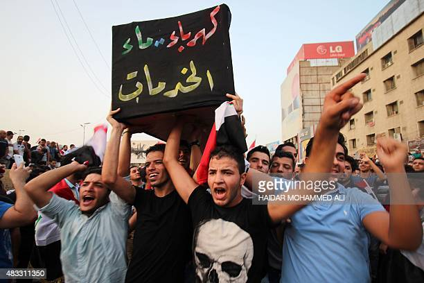 Iraqi men carry a coffin representing services during a demonstration against corruption and poor services in Baghdad on August 7 2015 Several...