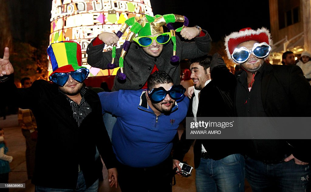 Iraqi men celebrate on new year's eve in Beirut, early on January 1, 2013.