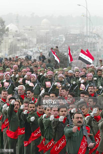 Iraqi men participate during a march in defiance of US threats to invade Iraq February 4 2003 in the city of Mosul 450 kilometers north of Baghdad...
