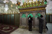 Iraqi men pray inside the Sayyid Mohammed shrine in the Balad area located 70 kilometres north of Baghdad on July 8 in the aftermath of a mortar and...