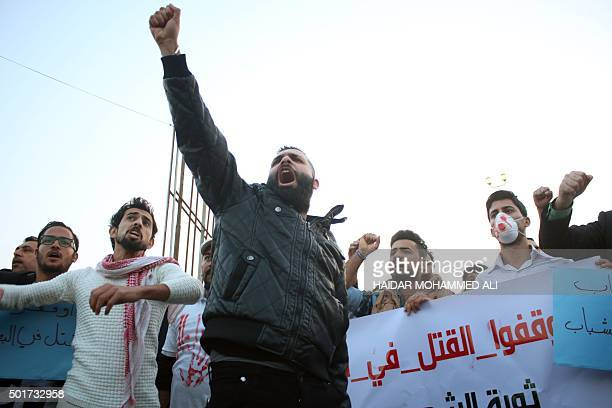 Iraqi men shout slogans during a demonstration against the ongoing violence and lack of security in the southern city of Basra on December 17 2015...