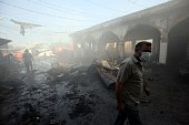 Iraqi men stands amid debris at the aftermath scene of a mortar and bombing attack on the Sayyid Mohammed shrine in the Balad area located 70...