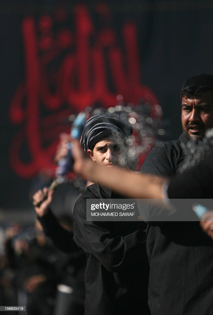 Iraqi men take part in the Arbaeen religious festival which marks the 40th day after Ashura commemorating the seventh century killing of Prophet Mohammed's grandson, Imam Hussein, in the shrine city of Karbala, southwest of Iraq's capital Baghdad, on December 31, 2012. A wave of bombings and shootings killed 12 people as Iraq grappled with anti-government protests and simmering political crises ahead of major Shiite Muslim commemoration rituals.