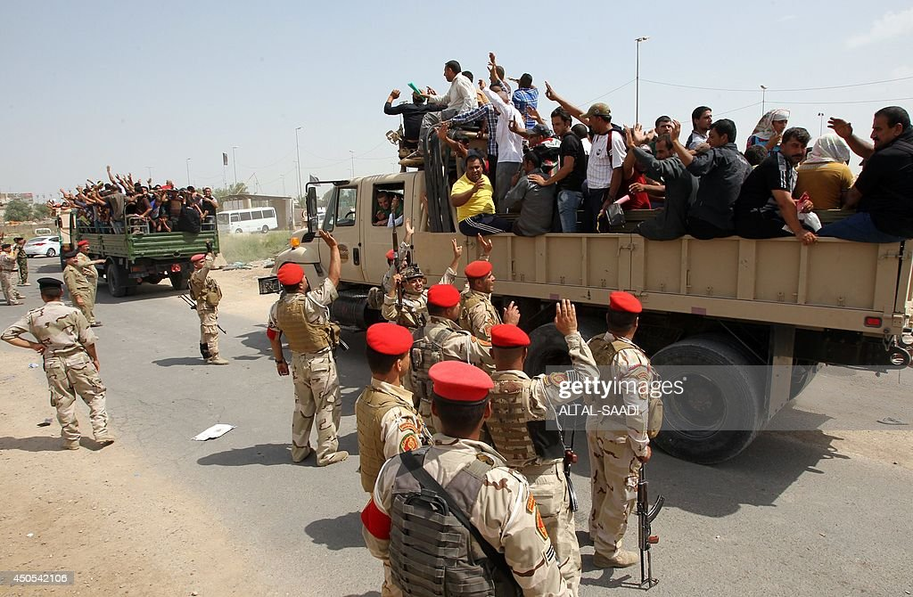 Iraqi men who volunteered to join the fight against a major offensive by jihadists in northern Iraq stand on army trucks as they leave a recruiting center in the capital Baghdad on June 13, 2014. Iraqi forces clashed with militants advancing on the city of Baquba, just 60 kilometres (40 miles) north of Baghdad, as an offensive spearheaded by jihadists drew closer to the capital.