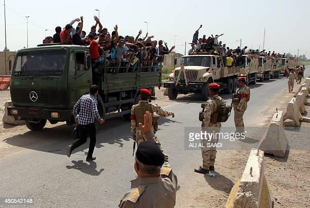 Iraqi men who volunteered to join the fight against a major offensive by jihadists in northern Iraq stand on army trucks as they leave a recruiting...