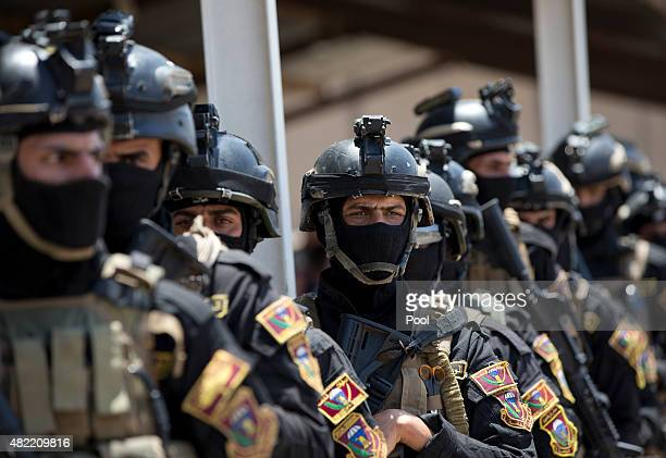Iraqi military train at the Counter Terrorism Service training location as observed by US Defense Secretary Ash Carter in Baghdad Iraq Thursday July...