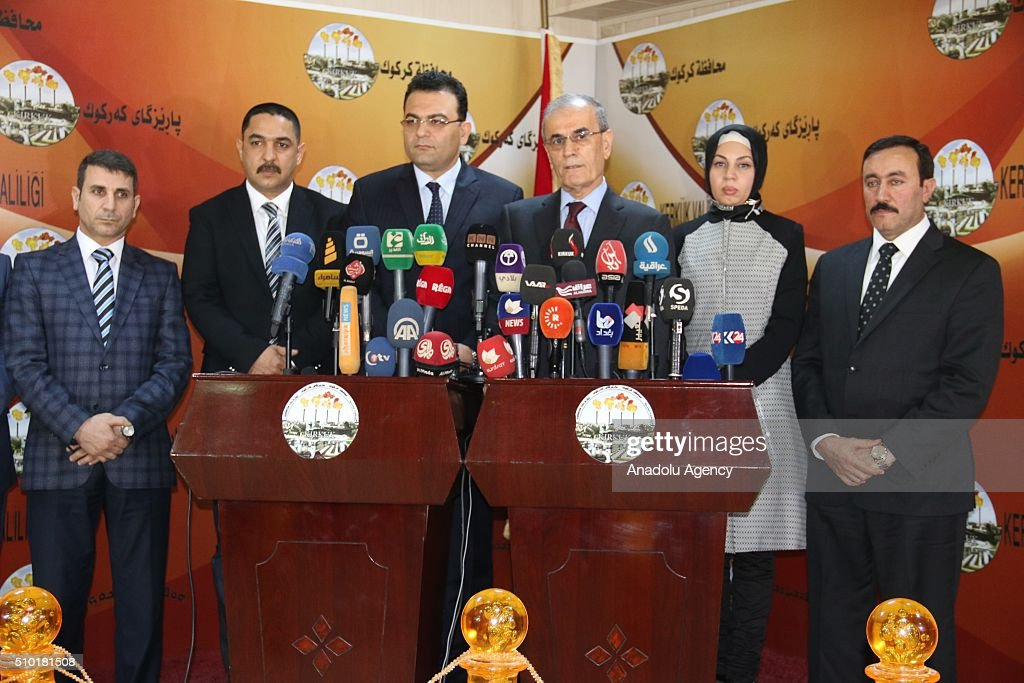 Iraqi minister for Immigration and Immigrants Derbaz Mohammed (C-L) and Governor of Kirkuk Najmaldin Karim (C-R) hold a joint press conference following their meeting in Kirkuk, Iraq on February 14, 2016.