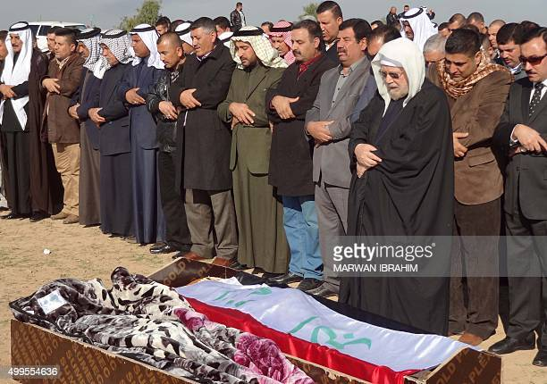 Iraqi mourners attend on December 2 2015 the funeral of Mohammed Khalil alJuburi the most senior Arab member of the Kirkuk provincial council after...