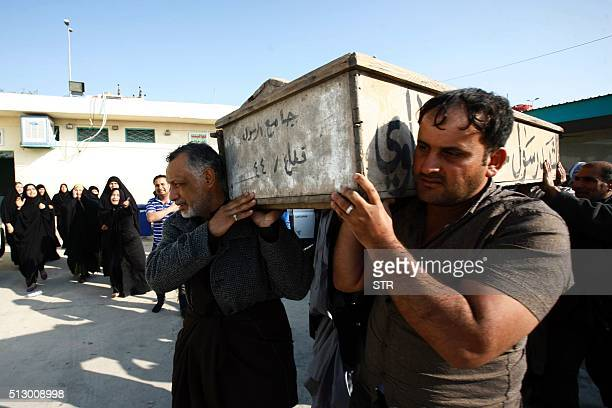 Iraqi mourners carry a coffin during the funeral of victims of bombings the previous day in Baghdad's mostly Shiite Sadr City district on February 29...