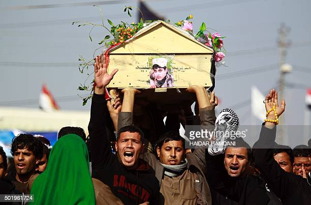 TOPSHOT Iraqi mourners carry the body of one of the soldiers who were killed the previous day in a socalled friendly fire from a USled coalition...