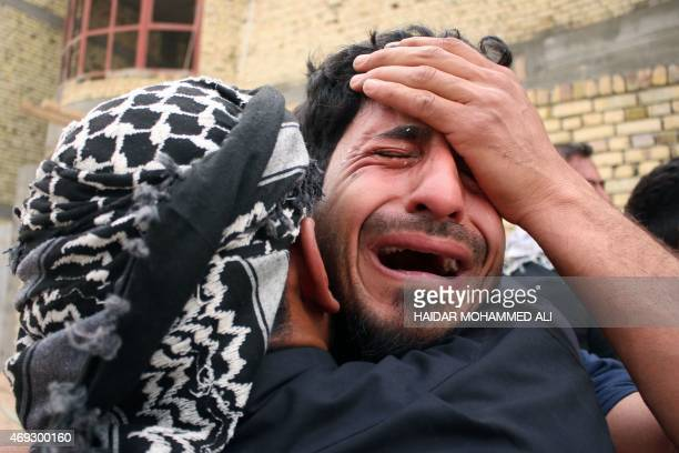 Iraqi mourners react during the funeral of a man who died in Tikrit in fighting alongside government forces against the Islamic State group on April...