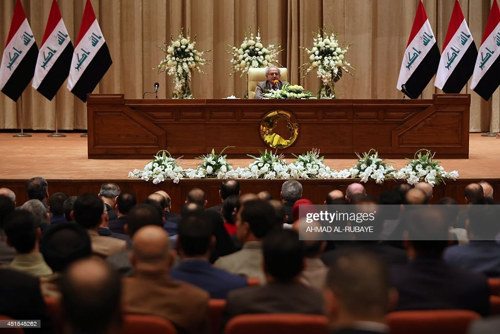 Iraqi MP Mahdi Hafez speaks as he presides over the first session of the new parliament on July 1 2014 in the capital Baghdad Iraq's new parliament...