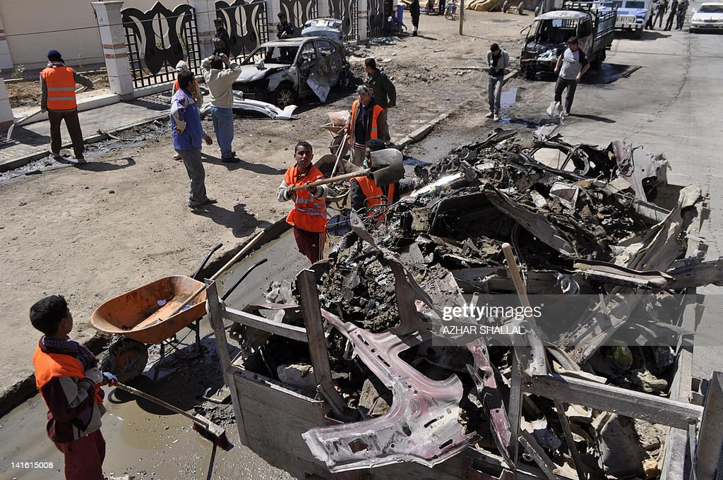 Iraqi municipality workers clean the site of a car bomb in Ramadi, capital of western Anbar province, that killed two people and wounded 11, on March 20, 2012. A wave of attacks in a dozen Iraqi cities killed at least 44 people on the anniversary of the US-led invasion of the country, just days before Baghdad hosts a landmark Arab summit.