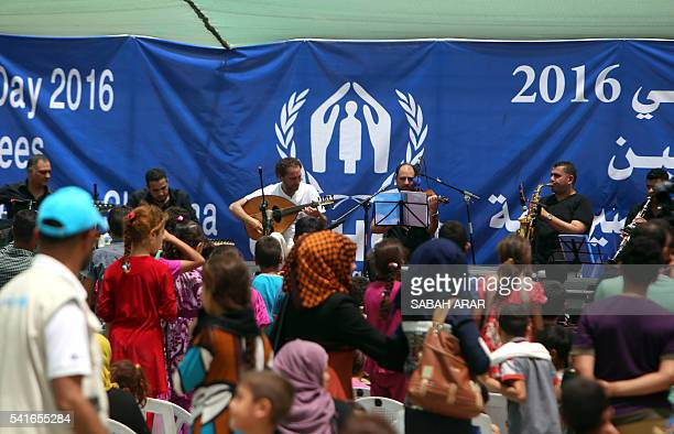 Iraqi musician Naseer Shamma performs during an event marking World Refugee Day at the Salam camp for people displaced from Ramadi and Tikrit on the...