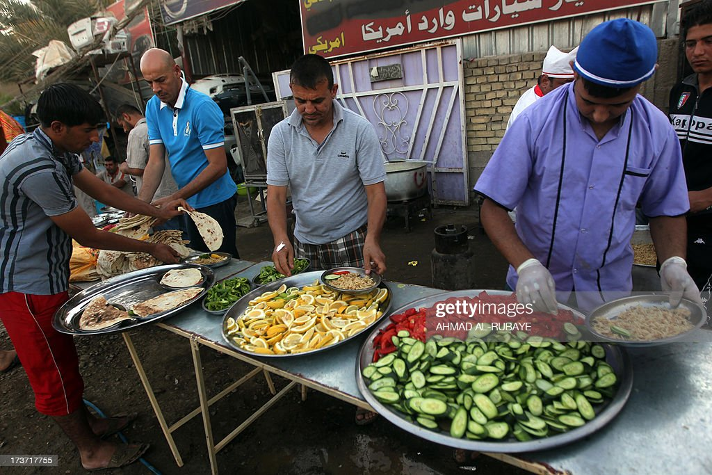 Iraqi Muslim men prepare food before breaking their fast in a meal known as Iftar inside a tent dedicated to cooking and eating during Ramadan, which is the first of its kind in the capital Baghdad. A group of Iraqi businessmen are providing free Iftar meals for poor people during Islam's holy fasting month of Ramadan where observers must abstain from food, drink and sex from dawn to dusk.