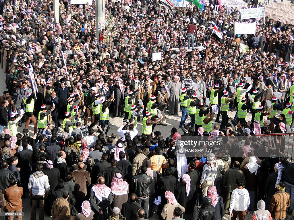 Iraqi muslims gather during a ceremony commemorating the birth of Prophet Mohammed, known in Arabic as 'al-Mawlid al-Nabawi', in the western city of Ramadi on January 24, 2013.