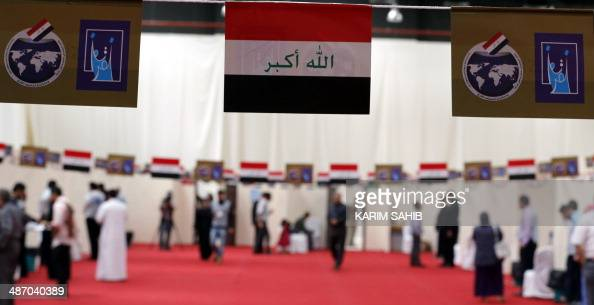 Iraqi nationals residing in the UAE casts their ballot for Iraq's parliamentary elections at a polling station in Dubai on April 27 2014 Iraqi expats...