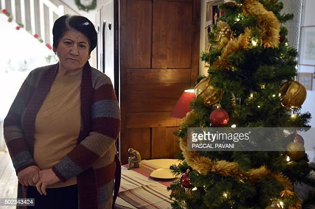 Iraqi Nivea stands next to a Christmas tree in her living room in Pibrac in the HauteGaronne region on December 23 2015 The Iraqi family's home was...