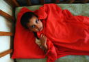 Iraqi orphan Yasser Amar 6 lies in bed in a local orphanage April 23 2003 in Baghdad Iraq The orphanage which previously housed about sixty children...