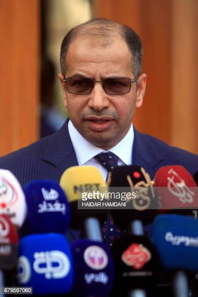 Iraqi parliament speaker Salim alJuburi speaks during a joint press conference with Iraqi cleric Moqtada Sadr in Iraq's central shrine city of Najaf...