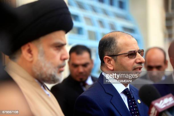 Iraqi parliament speaker Salim alJuburi speaks during a joint press conference with Iraqi cleric Moqtada Sadr in the central shrine city of Najaf on...