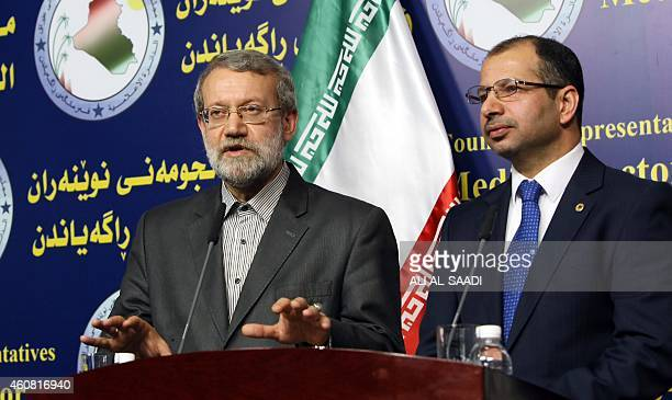 Iraqi Parliament's speaker Salim alJabouri stands next to his Iranian counterpart Ali Larijani during a press conference following a meeting on...