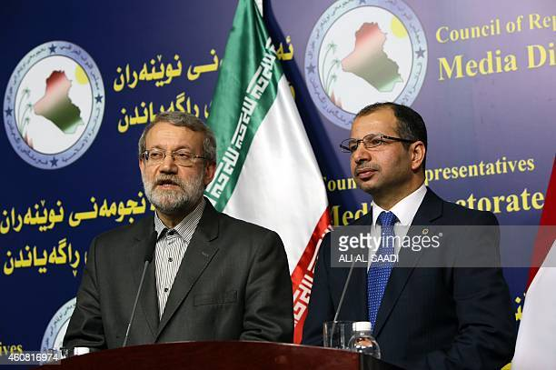 Iraqi Parliament's speaker Salim alJabouri stands next to his Iranian counterpart Ali Larijani speaking during a press conference following a meeting...
