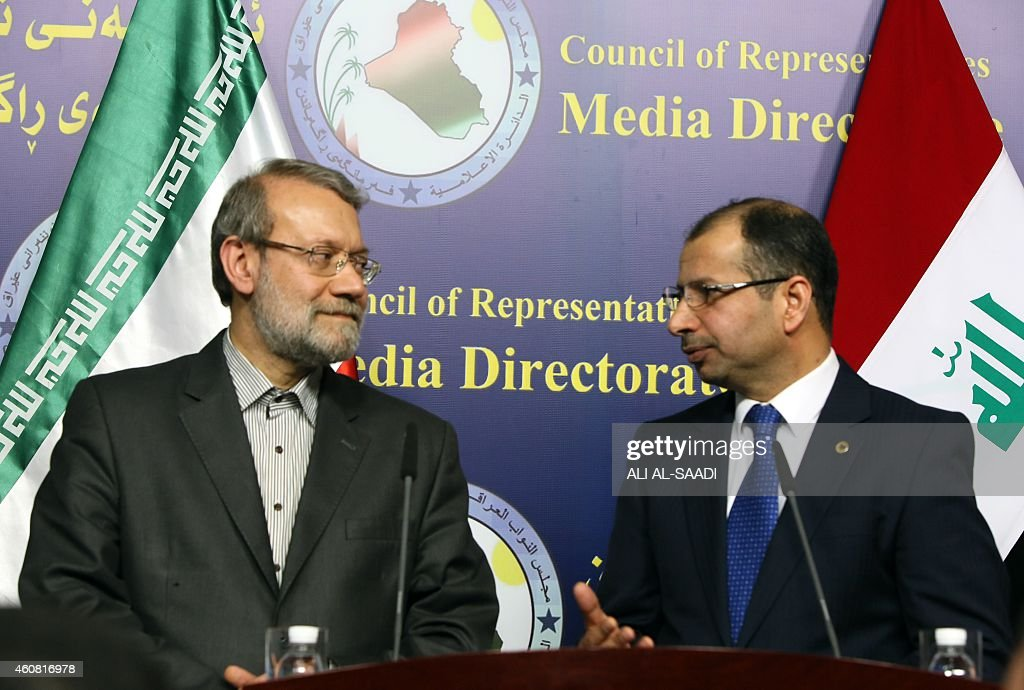 Iraqi Parliament's speaker Salim al-Jabouri (R) talks to his Iranian counterpart <a gi-track='captionPersonalityLinkClicked' href=/galleries/search?phrase=Ali+Larijani&family=editorial&specificpeople=572030 ng-click='$event.stopPropagation()'>Ali Larijani</a> during a press conference following a meeting on December 24, 2014 in the Iraqi capital Baghdad.