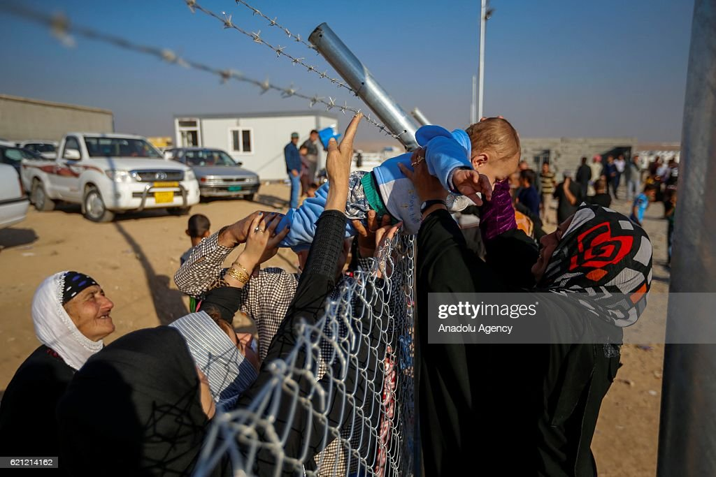 Iraqi people at Khazir refugee camp meet with their relatives in Erbil after they had fled from clashes between Iraqi army forces and Daesh terrorists at al-Malayin, al-Samah, al-Khazra, Kirkukli, al-Quds and al-Karama districts, as the operation to retake Iraq's Mosul from Daesh terrorists continues in Mosul, Iraq on November 5, 2016. A much anticipated Mosul offensive to liberate the city from Daesh began midnight of 16th of October 2016.