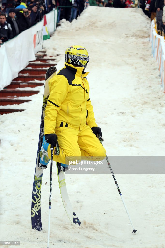 Iraqi people attend the ski show within the winter festival held at Korek Mountain at Iraqi Kurdish regional administration, in Arbil, Iraq on January 31, 2014. A ski run is established with carried snow. Arbil is announced as the 2014 Arabic Capital of Culture. A skier performs his skills at the ski run.