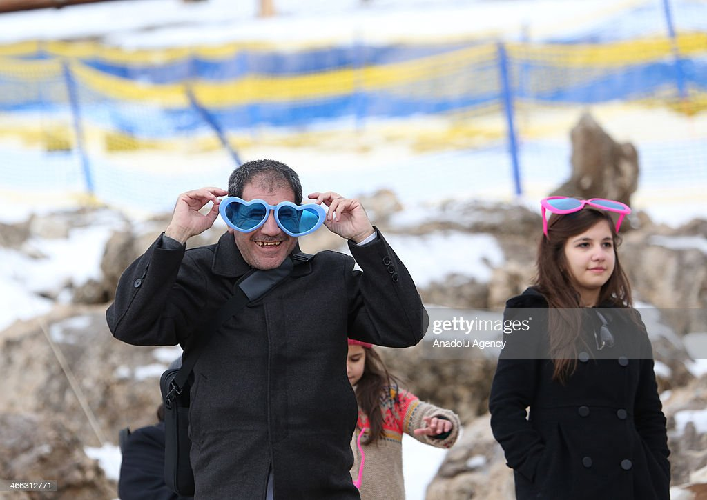Iraqi people attend the ski show within the winter festival held at Korek Mountain at Iraqi Kurdish regional administration, in Arbil, Iraq on January 31, 2014. A ski run is established with carried snow. Arbil is announced as the 2014 Arabic Capital of Culture.