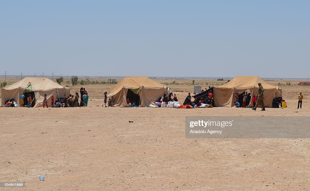 Iraqi people, escaping from their home due to conflicts between Daesh and security forces, are seen at the area, controlled by army in Anbar, Iraq on May 26, 2016.