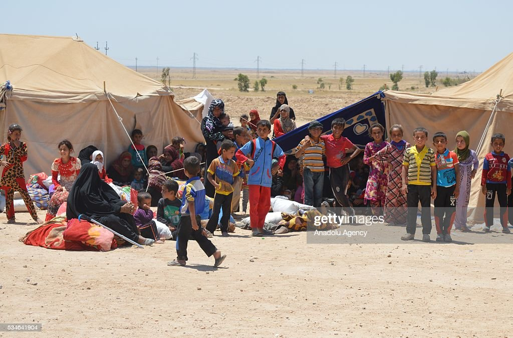 Iraqi people, escaping from their home due to conflicts between Daesh and security forces, are seen around tents, controlled by army in Anbar, Iraq on May 26, 2016.