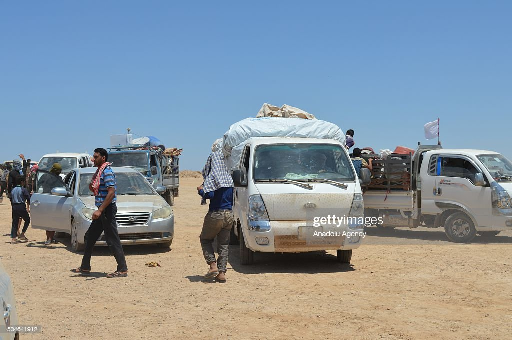 Iraqi people, escaping from their home due to conflicts between Daesh and security forces, prepare to go to security zone, controlled by army in Anbar, Iraq on May 26, 2016.