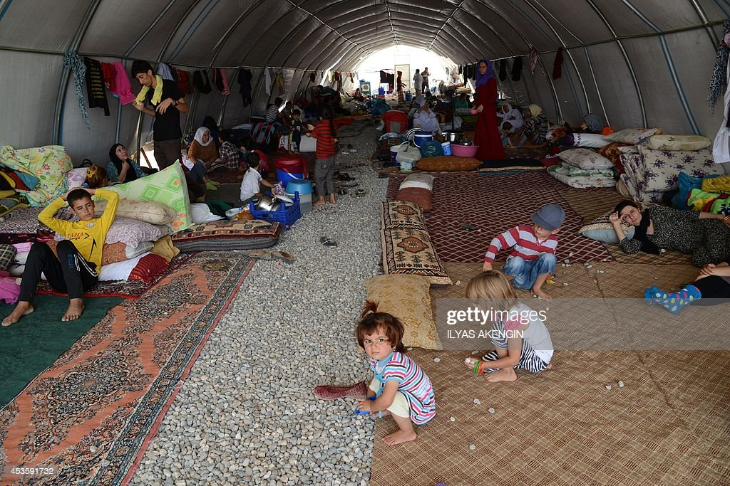 Iraqi people from the Yazidi community are pictured in a refugee camp near the TurkeyIraq border at Silopi in Sirnak on August 14 2014 The United...