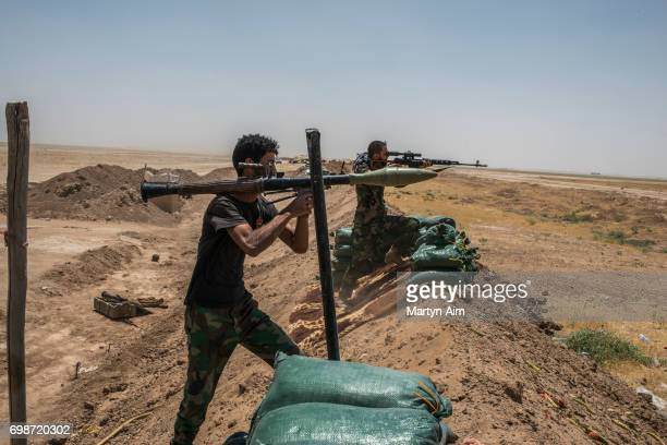 Iraqi PMF fighters on June 20 2017 on the IraqSyria border in Nineveh Iraq The Popular Mobilisation Front forces composed of majority Shi'ite militia...