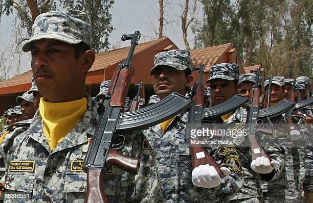 Iraqi police cadets march during their graduation ceremony at the Iraqi National Police Special Training Academy on April 30 2009 in Baghdad Iraq...