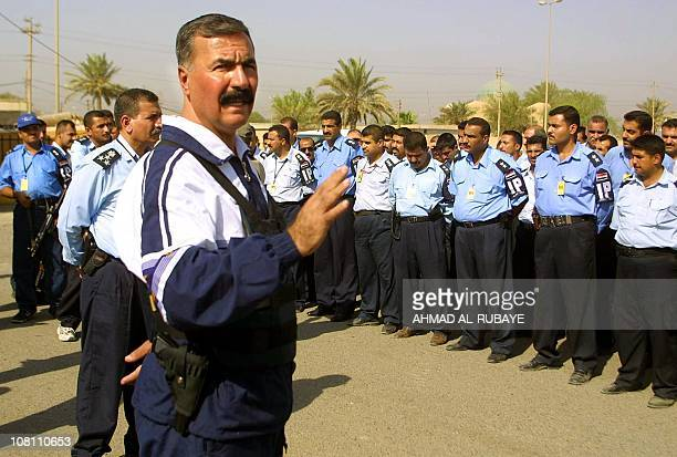 Iraqi Police Chief Ahmed Ibrahim addresses his officers as they presented 23 August 2003 weapons to the press after conducting dawn raids on houses...