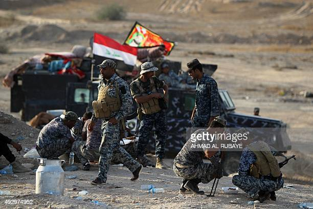 Iraqi police fighting alongside Iraqi forces and Popular Mobilisation units rest in the town of Baiji north of Tikrit during fighting against the...
