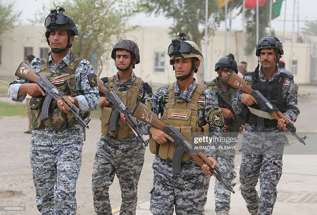 Iraqi policemen are seen inside a military base in Baghdad, on June 11, 2014, after the parliament had received a joint request from Iraqi Prime Minister Nuri al-Maliki and the president's office to declare a state of emergency -- the procedure laid down in the constitution. Jihadists seized in the city of Mosul, Iraq's second and Nineveh province on June 10, in a major blow to the government apparently unable to halt the progress of armed.